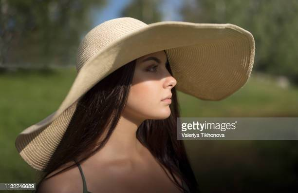young woman in floppy sun hat - drooping stock photos and pictures