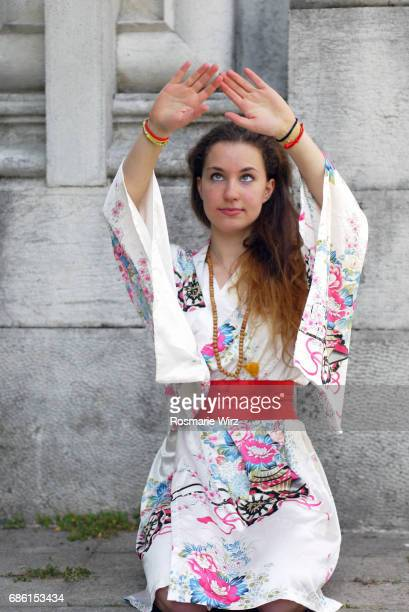 Young woman in floral kimono