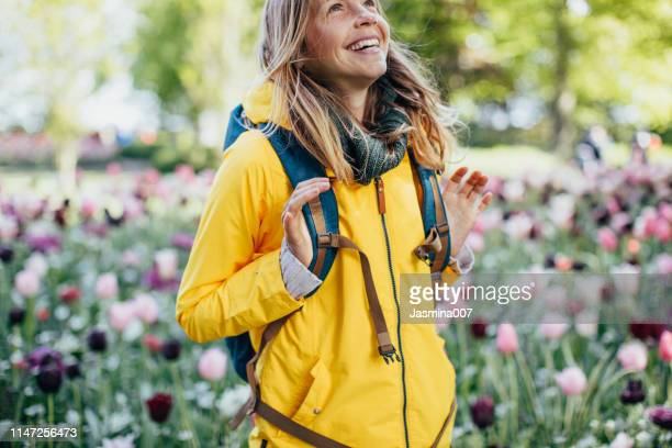 young woman in flower park in netherlands - south holland stock pictures, royalty-free photos & images