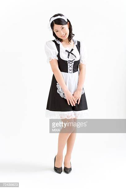 A young woman in French maid outfit smiling