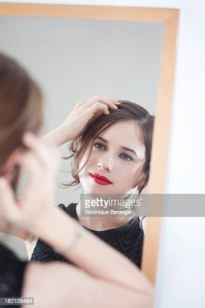 young woman in front of a mirror - gray eyes stock pictures, royalty-free photos & images