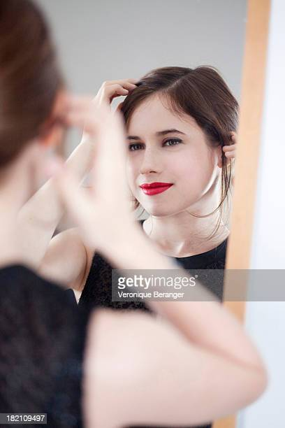 Young woman in front of a mirror