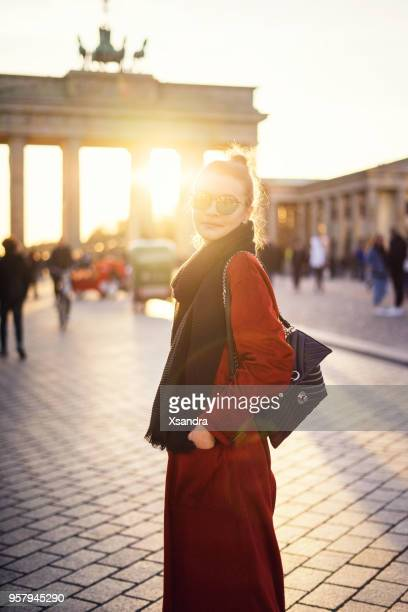 young woman in front of brandenburger tor in berlin, germany - wonderlust stock pictures, royalty-free photos & images