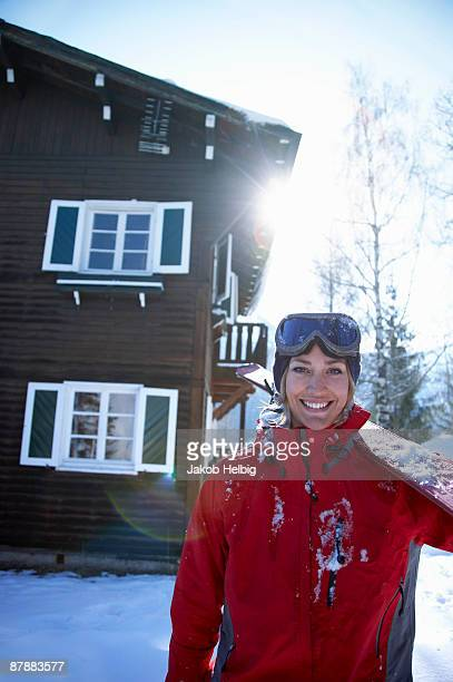 young woman in front of chalet with ski - courchevel stock pictures, royalty-free photos & images