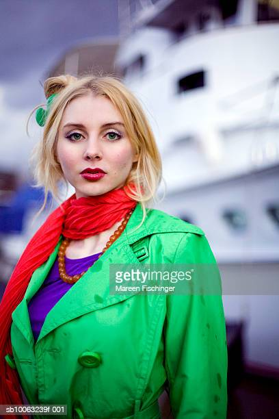 Young woman in front of cruise ship, portrait