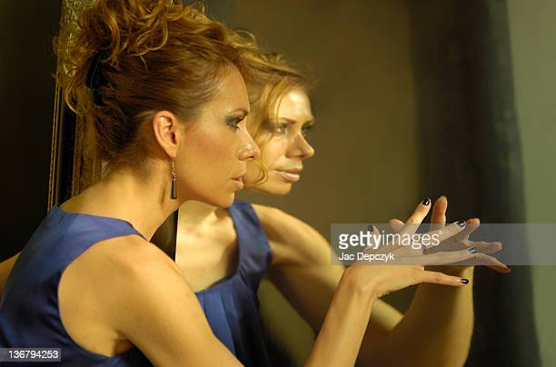young woman in front of distorted mirror - depczyk stock pictures, royalty-free photos & images