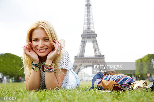 Young woman in front of Eiffel Tower