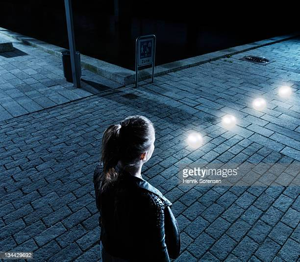 young woman in front of glowing balls