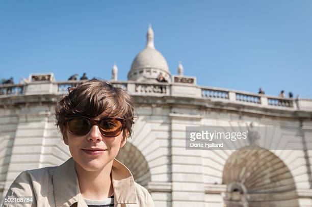 Young woman in front of Sacre Coeur in Paris