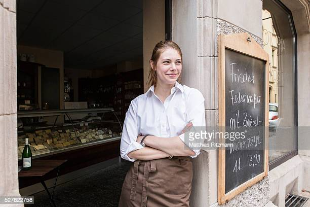 Young woman in front of shop