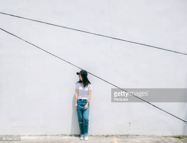 Young woman in front of white wall