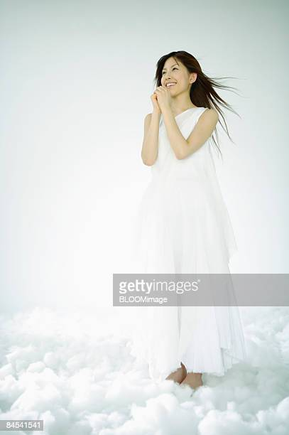 young woman in goddess costume, studio shot - 祈る ストックフォトと画像
