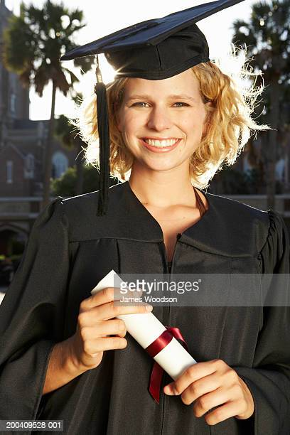 young woman in graduation cap and gowns smiling, portrait, close-up - erin james stock-fotos und bilder