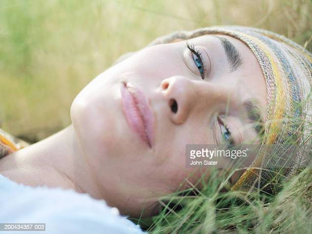 young woman in grass, smiling, portrait, close-up - one young woman only stock pictures, royalty-free photos & images