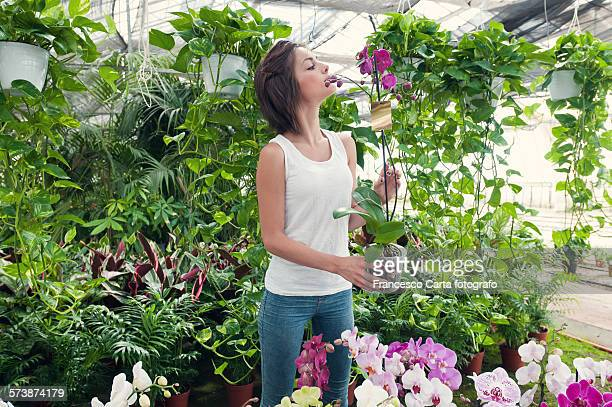 Young woman in greenhouse