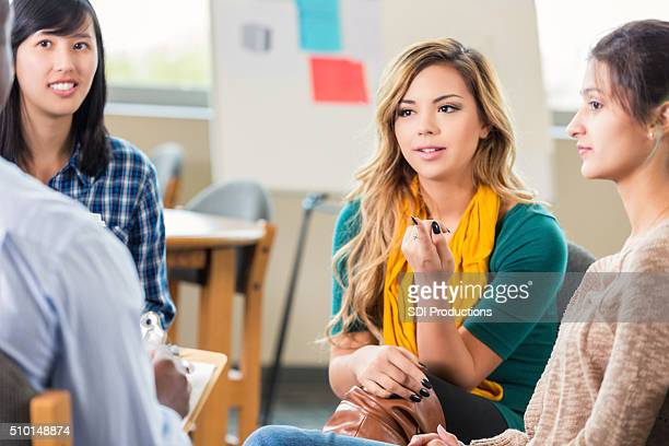 Young woman in group therapy or support group
