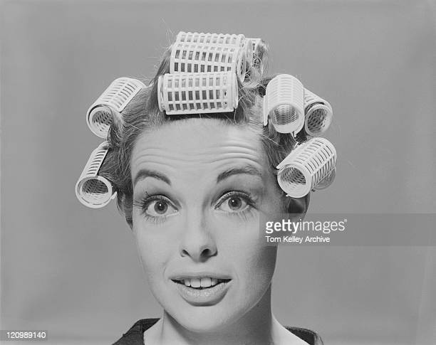 young woman in hair rollers, smiling, portrait - 1965 stock pictures, royalty-free photos & images