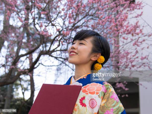 Young woman in hakama deep breathing after graduation ceremony