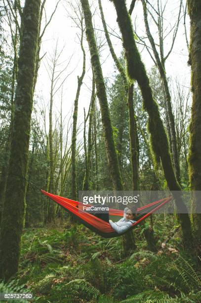 Young woman in hammock in forest