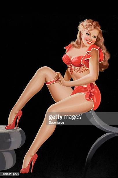 Young woman in high heels and two piece suit with dangles and long tresses of red hair pulls up her garter belt for her silk stockings 1948 By Peter...