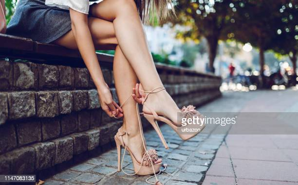 young woman in high heels - legs and short skirt sitting down stock pictures, royalty-free photos & images