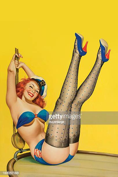 Young woman in high heels two piece suit is sitting with her legs raised revealing her buttocks as she leans back holding a rope and wears a sailor's...