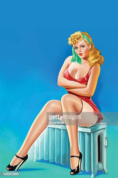 Young woman in high heels two piece suit sits on a radiator she holds herself as she has the chills She wears black silk stockings with garter belt...