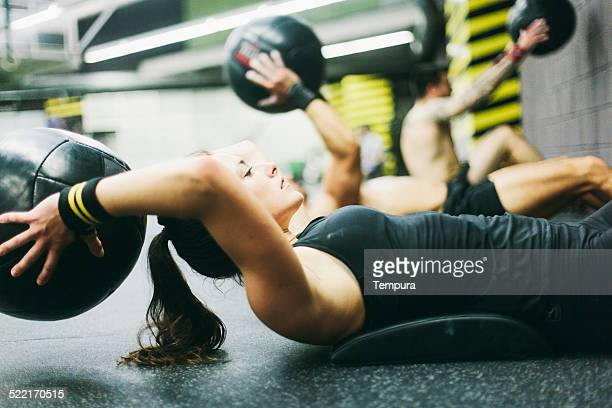 young woman in high intensity fitness session. - crossfit stock pictures, royalty-free photos & images