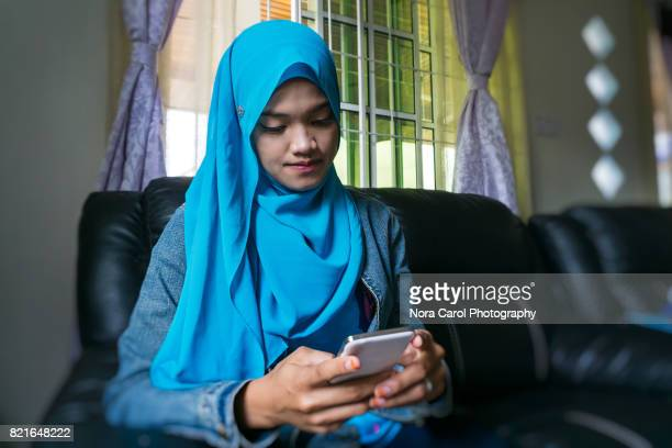 Young Woman in Hijab with Smart Phone