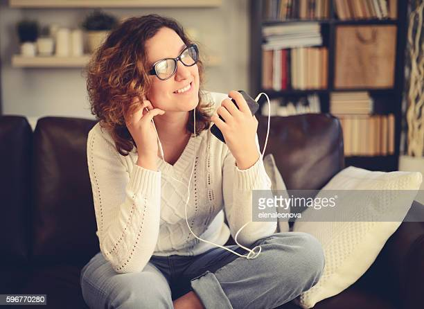 young woman in home interior - audio equipment stock pictures, royalty-free photos & images