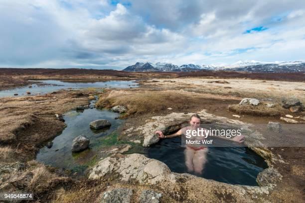 Young woman in hot spring, Eyjar og Miklaholt, Western Region, Iceland