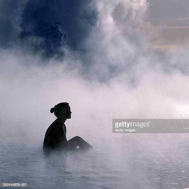 young woman in hot spring, side view - hot spring stock pictures, royalty-free photos & images