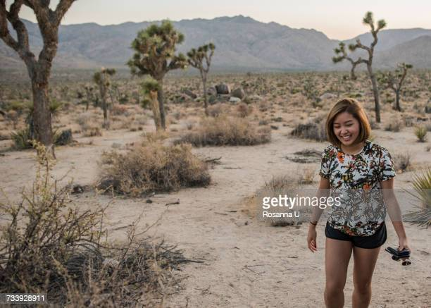 Young woman in Joshua Tree National Park at dusk, California, USA