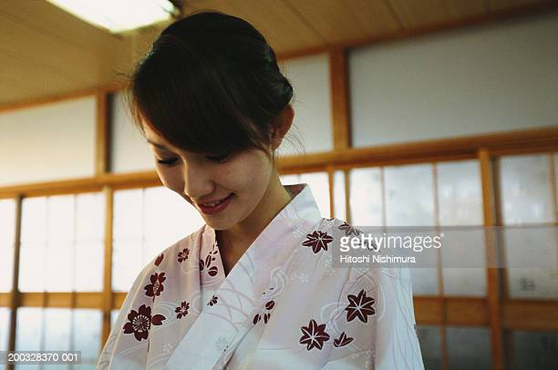 Young woman in kimono, looking down, close-up
