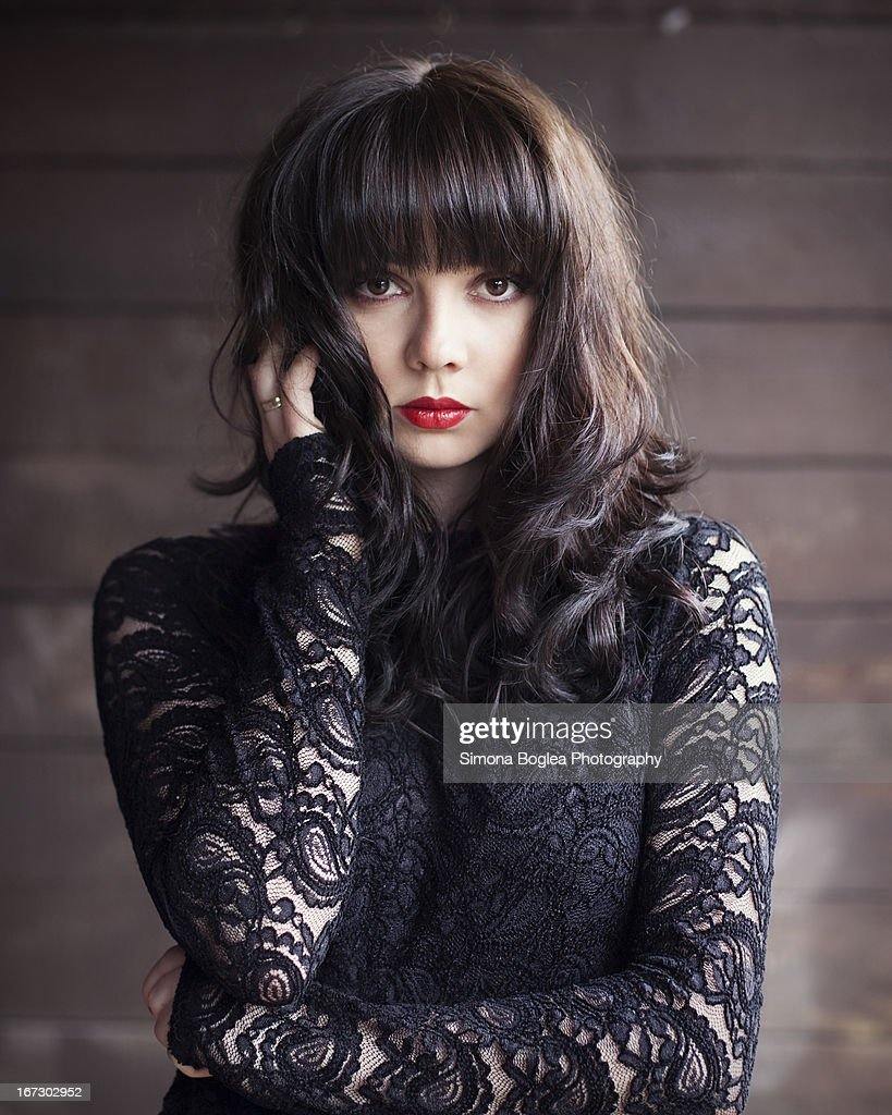 Young woman in lace dress : Stock Photo