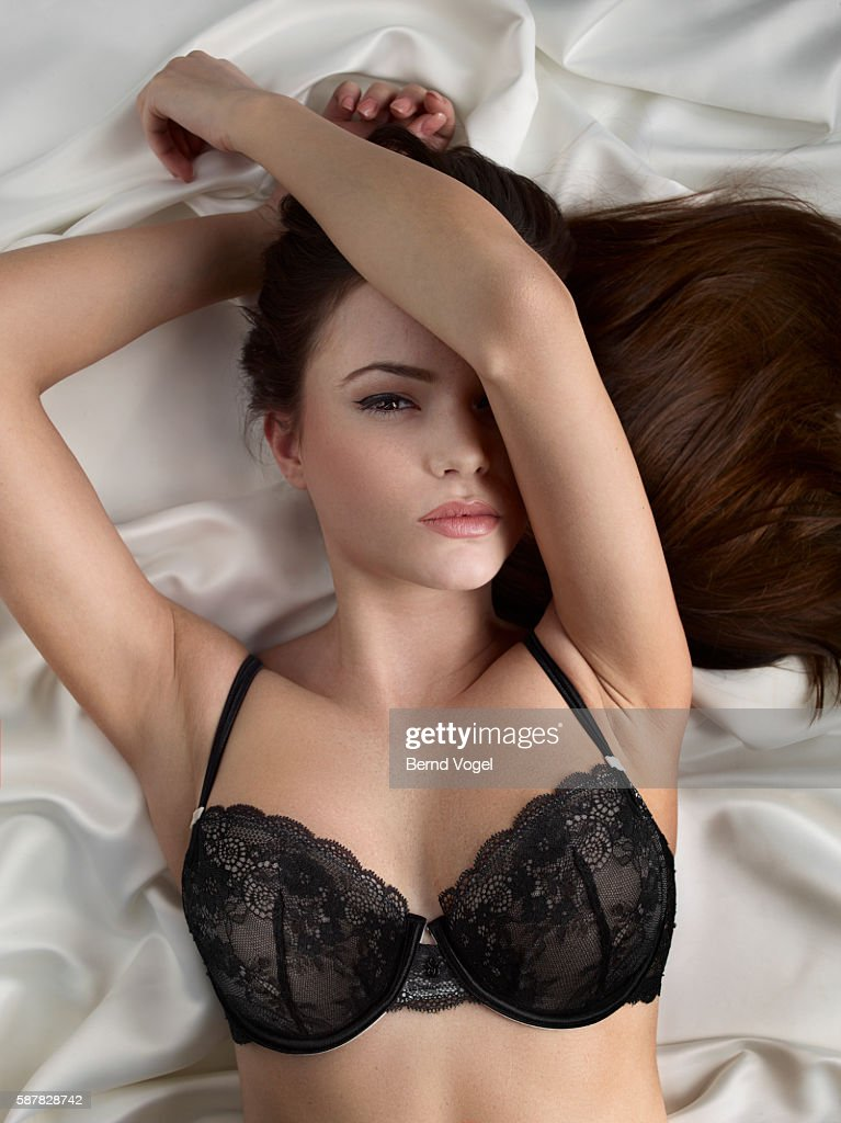 Young Woman In Lace Lingerie Laying On Silk Blanket Stock -8805
