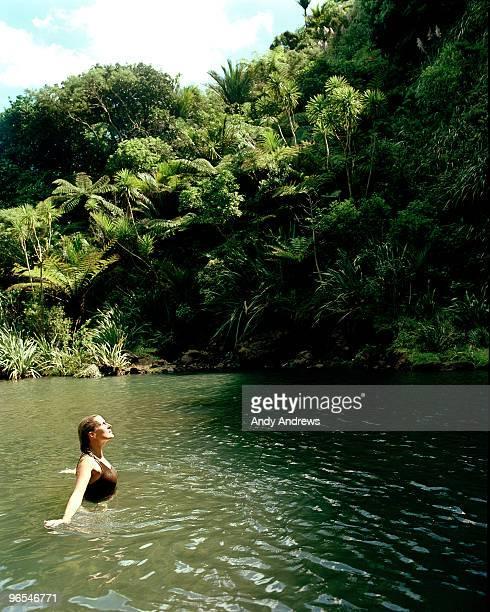 Young woman in lagoon enjoying the sun