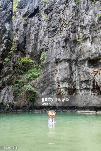 young woman in lagoon - lagoon stock pictures, royalty-free photos & images