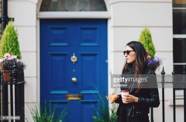 young woman in london having a coffee on the go - west end london stock photos and pictures
