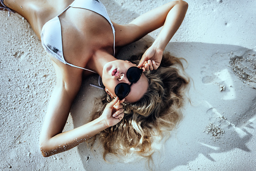 young woman in Maldives in sunglasses in bikini enjoying vacation, beach holidays, lifestyle, beautiful young adult woman, tropical island, resort, turquoise water - gettyimageskorea