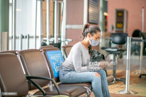 young woman in mask in the airport - fatcamera stock pictures, royalty-free photos & images