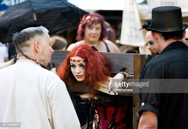 young woman in medieval costume on wave gothic meeting leipzig - pillory stock photos and pictures