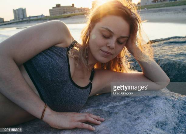 Young Woman In Meditative State At Beach