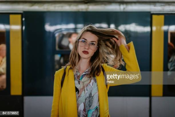 young woman in milan subway station - yellow coat stock pictures, royalty-free photos & images