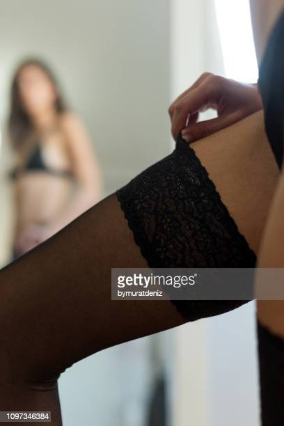 young woman in mirror showing off garter - knickers off stock pictures, royalty-free photos & images
