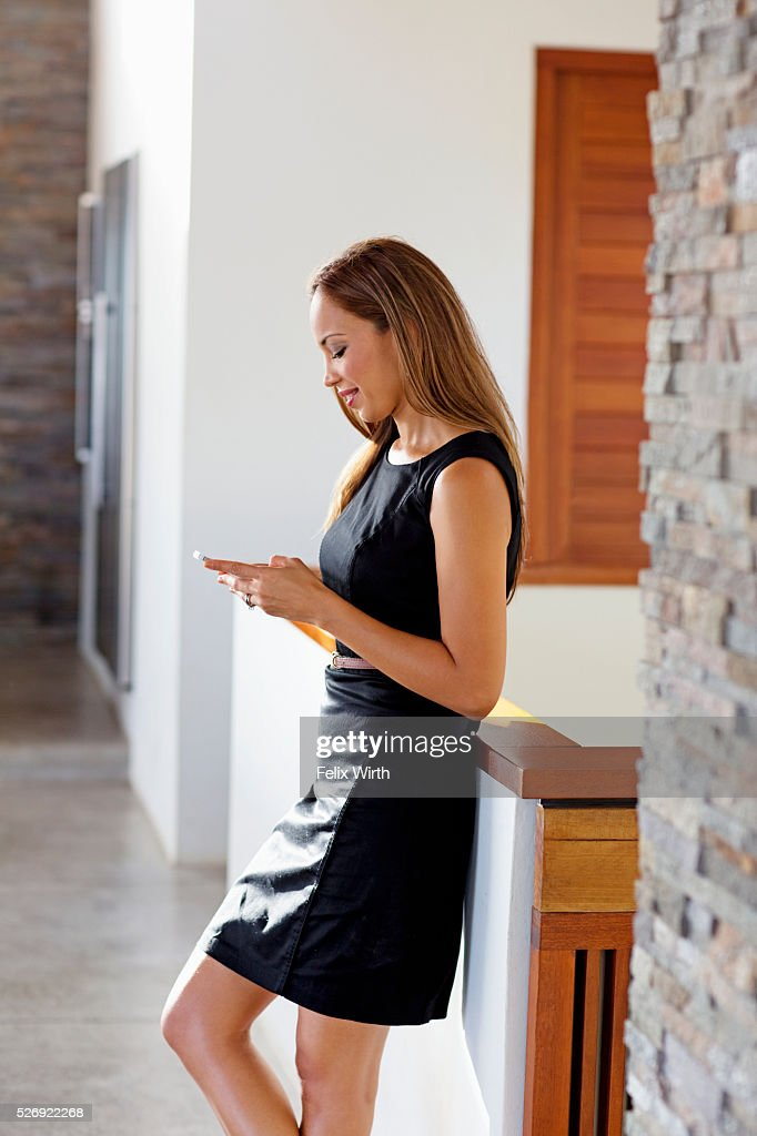 Young woman in modern home : Stock-Foto