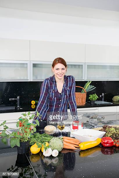 Young woman in modern kitchen