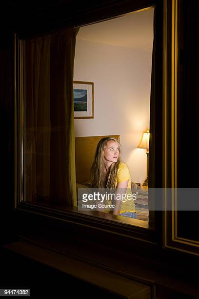 young woman in motel room - motel stock photos and pictures
