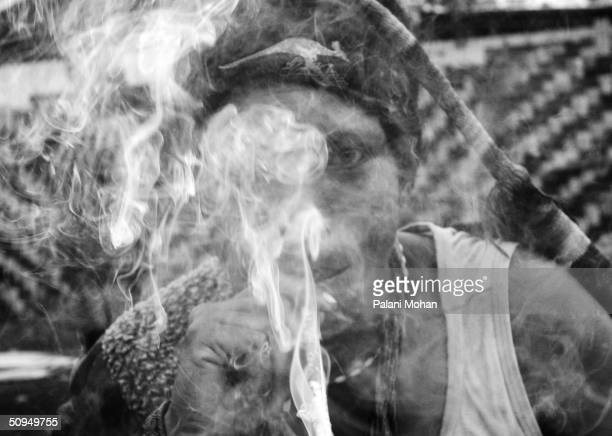 A young woman in Mt Hargen in the high lands of Papua New Guinea smokes a home grown weed April 27 2004 Young women are the most venerable in the...