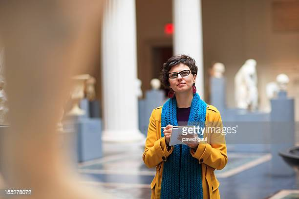 young woman in museum - museum stock pictures, royalty-free photos & images